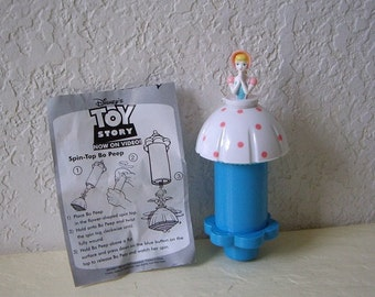 Toy Story Character, Bo Peep. Spinning toy with ejector and directions, Burger King Toy, 1996. Never used.