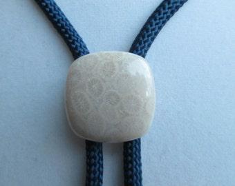 Fossil coral bolo tie- dark blue rayon cord