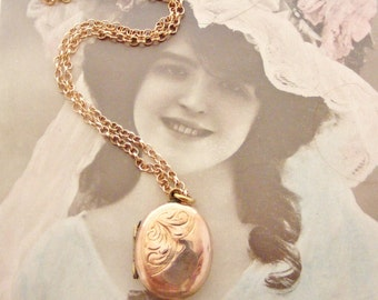 Edwardian oval locket rose gold back and front on rose gold fill chain