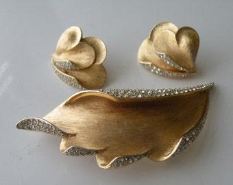 Trifari brushed gold plated  metal clear rhinestone leaf brooch pin, clip-on earrings. Set.