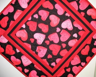 Valentine Table Topper  Hearts on black. quilted,  fabric from Benetarx