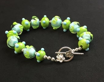 Handmade Whimsical Lime Green/Light Blue Glass Lampwork Beads and Sterling Silver Bracelet   Unique High Quality jewelry   OOAK Artist Made