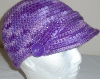 Crocheted newsboy hat/cap with peak/brim fit head size 21 to 23 inches around head.
