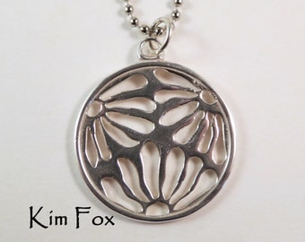 Round Asian Flower Pierced Pendant in sterling silver by Kim Fox