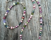 Freshwater pearls in many hues and Swarovski crystals. necklace and bracelet set, the perfect gift. Classic and yet a bit out of the box.