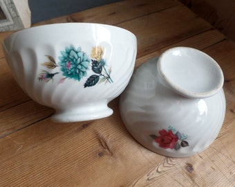 Vintage two french cafe au lait bowls  Embossed details  flowers patterns