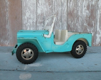 Vintage toy Buddy L metal bank truck , pretty turquoise and chippy paint , rusted