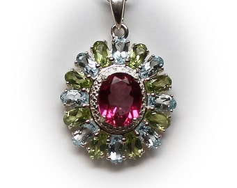 Lovely Sterling Silver Medallion Pendant with Pink Sapphire Center Stone accented with Aquamarine and Peridot