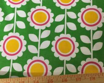 Robert Kaufman cute flowers on cotton Lycra. Medium weight. Four way stretch. Fabric is 58 inches wide. Price is per yard.