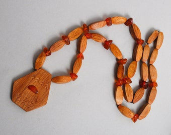 Vintage wood necklace with genuine Baltic amber beads. pendant