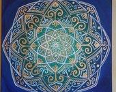 gold and white mandala on blue