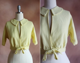 vintage 1960's pale yellow cropped linen jacket blouse with large bow / size s