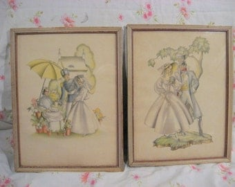 Two 1941 stylized Art deco prints, couple in muted colors, framed behind glass
