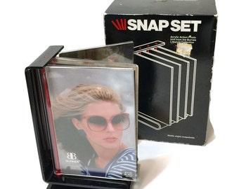 "Vintage 1980s Modernist Photo frame, Snap Set 3.5"" x 5"" vertical portrait format Black, clear acrylic, holds 8 photos"