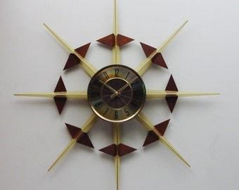 Starburst Clock by Elgin. Convertible Design Sunburst Clock with removable Walnut sliders.