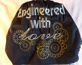 """SassyCloth one size pocket diaper with """"Engineered with love"""" embroidery on black PUL and geeky print at front. Ready to ship."""