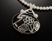Lotus open work bloodstone silver pendant