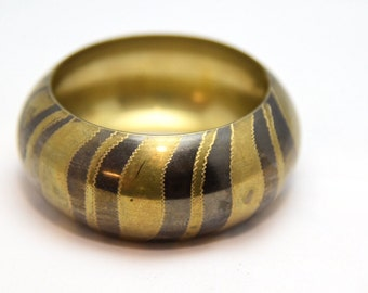 Chunky vintage brass bangle c1970 with zebra stripes