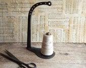 Vintage Cast Iron String Holder