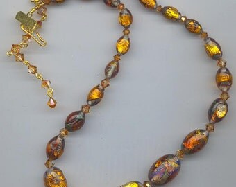 Gorgeous vintage necklace starring very rare and very beautiful fiery foiled lampwork glass  eads with opalescence