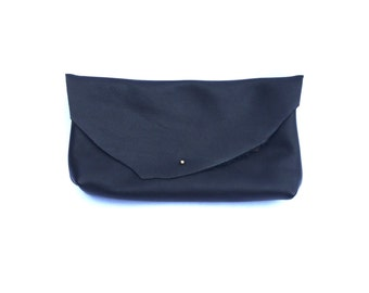 One-of-a-kind Raw Edge Clutch