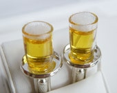 cufflinks beer glasses on silver tablet