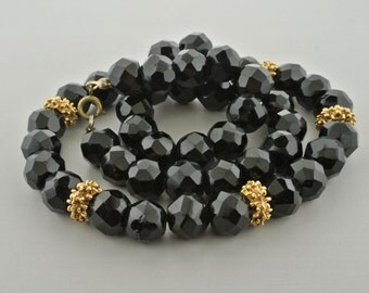 """Black Faceted Glass Bead Necklace with Gold Tone Spacers 19"""" Long."""