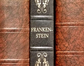 Frankenstein vintage book by Mary Shelley with faux leather binding in dark blue.