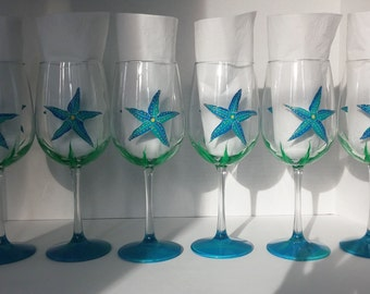 Teal and blue starfish Party hand painted wine glasses.