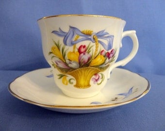 """VINTAGE Teacup & Saucer - Bone China, Pattern is called """"February Crocus"""" in basket tied with blue ribbon,  """"Arklow - Made In Ireland"""""""