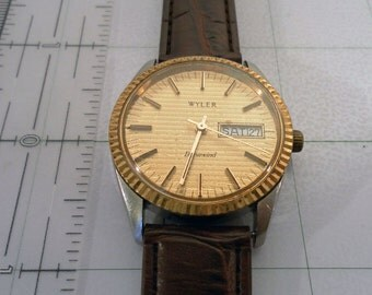 Vintage 1960-70's Wyler Dynawind Automatic Watch, Date and Time.  17 Jewel Swiss  Swiss Mvt ETA 2789-1. New Brn Leather Padded Band.