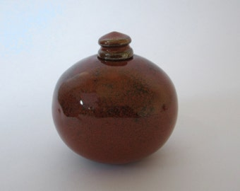 Small red ceramic bottle : perfume flask or ink pot with shiny red glaze