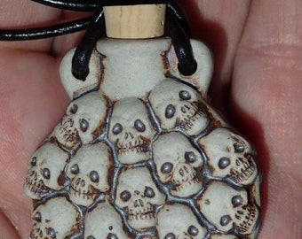 Ceramic Skull Bottle pendant on Leather