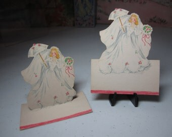 Adorable unused 1940's hallmark die cut bride place card pretty blonde haired bride holding a matching parasol and her bridal bouquet