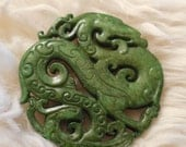 "Jade hand carved antique disk, pendant paperweight ""dragons unleashed"" 2- 1/2"" across and see pic for the thickness"