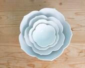 vintage white lotus nesting bowls / set of four