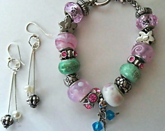Simple finds on the seaside shore with light ocean colors charm bracelet