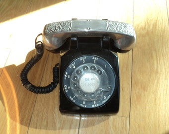 Vintage Black Rotary Telephone with Southwestern Style Silver plated metal relief design on the handset phone in good working condition