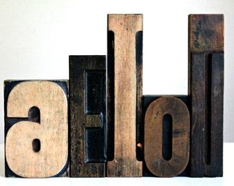 vintage wooden print block letters--vowel letters A E I O U---letterpress, old wood letters, typeset letters