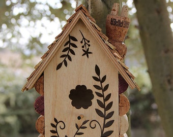 Laser cutout birdhouse, wine cork art