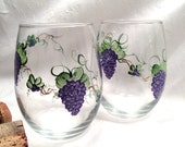 Stemless glasses painted with a custom design reserved for Donna