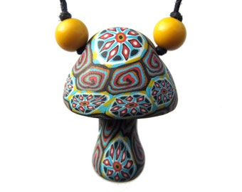 Mushroom pendant with millefiori starburst and spiral designs, tribal patterns, handmade from colorful polymer clay, on cord with beads