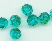 Twelve Swarovski crystals: art 5000 - 8 mm - blue zircon AB