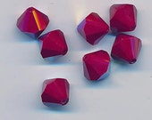 Wow - eight vintage Western Germany cherry red AB crystals - bicones - 12 mm