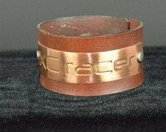 "XC racer on Copper riveted to 2"" Wide Leather Bracelet"