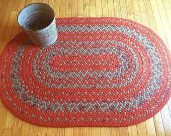 Deep Orange Corduroy and Green Flannel Large Oval Hand Braided Area Rug
