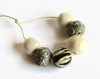 Black and white handmade ceramic beads, African beads, handmade African beads, zebra print bead, pottery beads from Africa