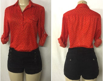 Red shirt with pocket and button back sleeves  S/M polyester