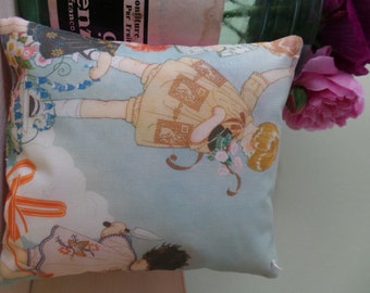 Hand printed onto fabric Art Deco image of little girls gardening which has been made into a little lavender pillow