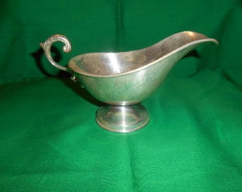 One (1). Solid Sterling Silver Gravy Boat by Mexican Silver Smith, Gonzalo Moreno.
